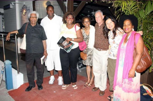 Authors, publishers, and readers of Caribbean literature, L-R, George Lamming (Barbados), Eric Fenwick (USA), Jacqueline Bishop (USA/Jamaica), Jacqueline A. Sample (USA/St. Martin), Emilio Jorge Rodriguez (Cuba), Wena Poon (USA/Singapore), Nicole Cage (Martinique), guests of St. Martin Book Fair. © 2012 HNP file photo.