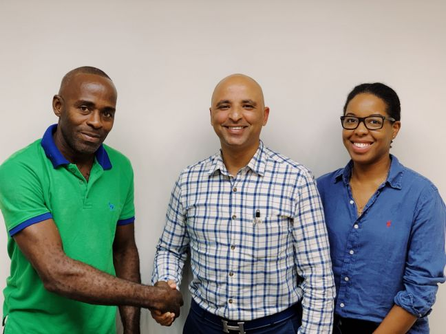 In photo (l-r): Geddes Smith of Elite Development Team, Milano Diamond Gallery Regional Manager Vick Makhija and SMDF Program and Development Manager Makhicia Brooks.