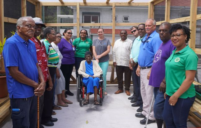 LIFE Center clients and some of their coaches with Commissioner Rolando Wilson, Bobby Zagers of the Planning Bureau, head of the Agricultural Department Randall Johnson and representatives of the the Saba Benevolent Foundation at the new greenhouse.